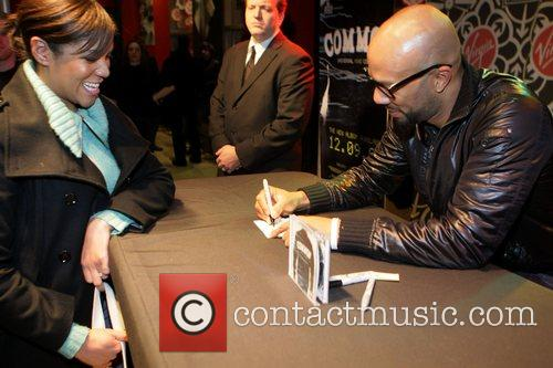 Common signs copies of his new album 'Universal...