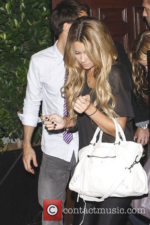 Lauren Conrad leaves Crown bar with a mystery...