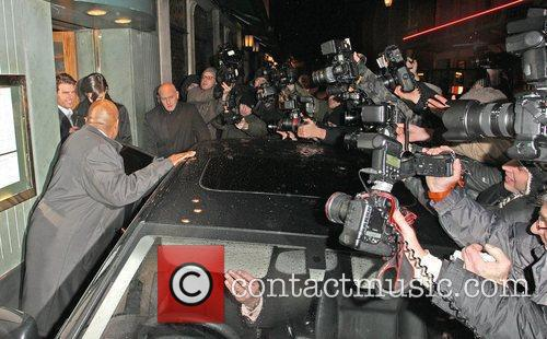 Tom Cruise and his wife Katie Holmes leave...