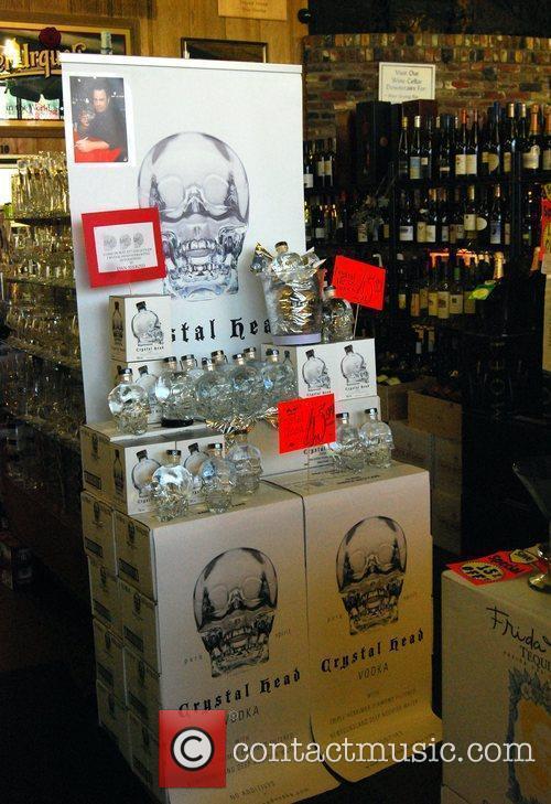 Dan Aykroyd signs bottles of his Crystal Head...