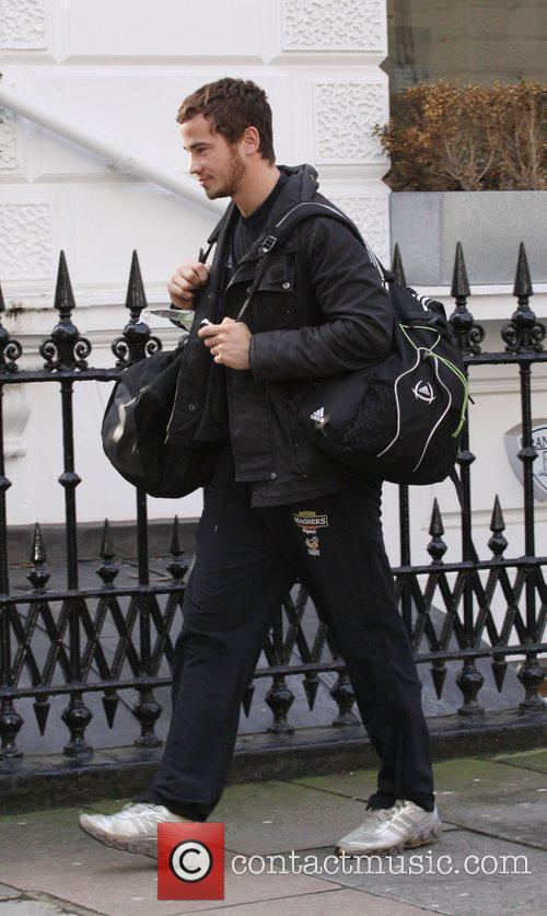 Looks tired as he leaves Kelly Book's home...