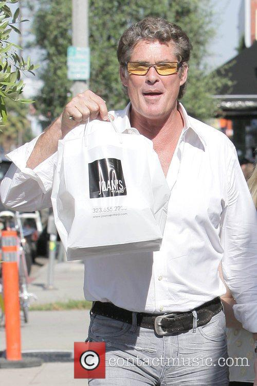 David Hasselhoff, carrying packed lunch, leaving Joan's on...