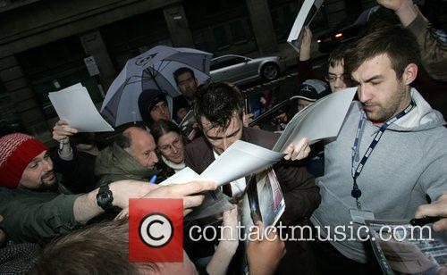 Is mobbed by fans as he arrives at...