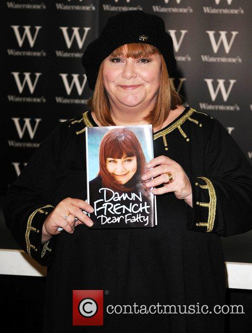 Signs copies of her new book 'Dear Fatty'