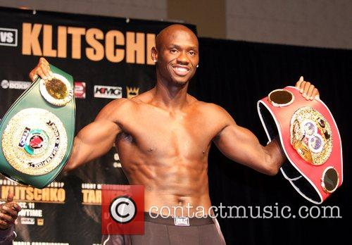 Antonio Tarver holds up his Championship IBF and...