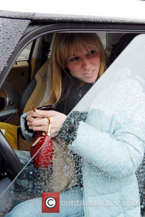 Debbie Gibson, wearing no makeup, makes a quick...
