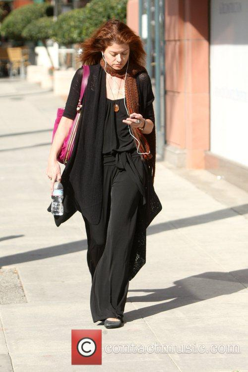 Debra Messing leaving Anastasia Salon while out and...