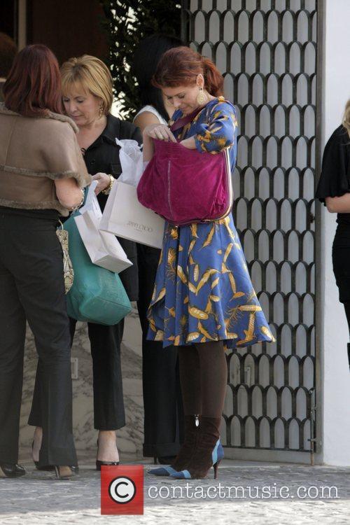 Debra Messing  exits a pre-Oscar party at...