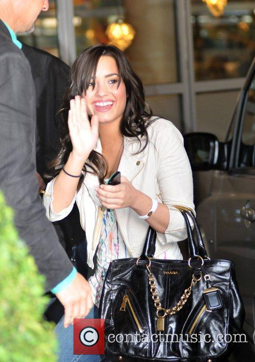 Demi Lovato arriving at her hotel after appearing...