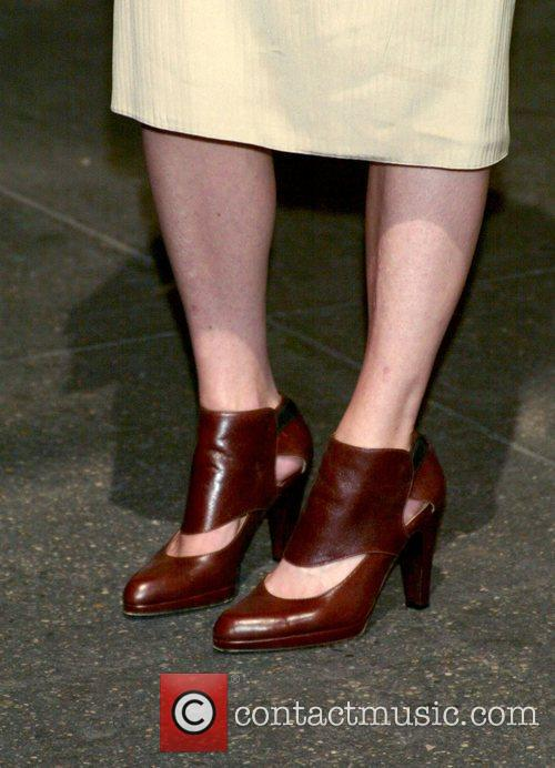 Mamie Gummer shows off her shoes at the...