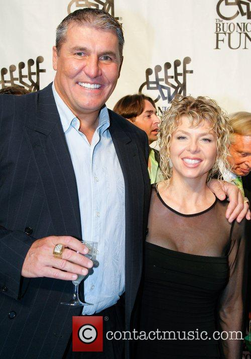 Mark Rypien and guest Destination Fashion 2009 -...