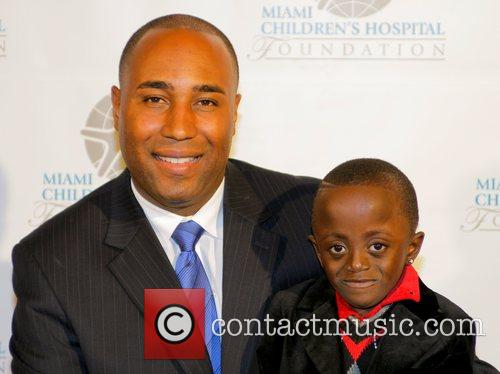 CBS reporter Jawan Strader with Adrian Richards a...