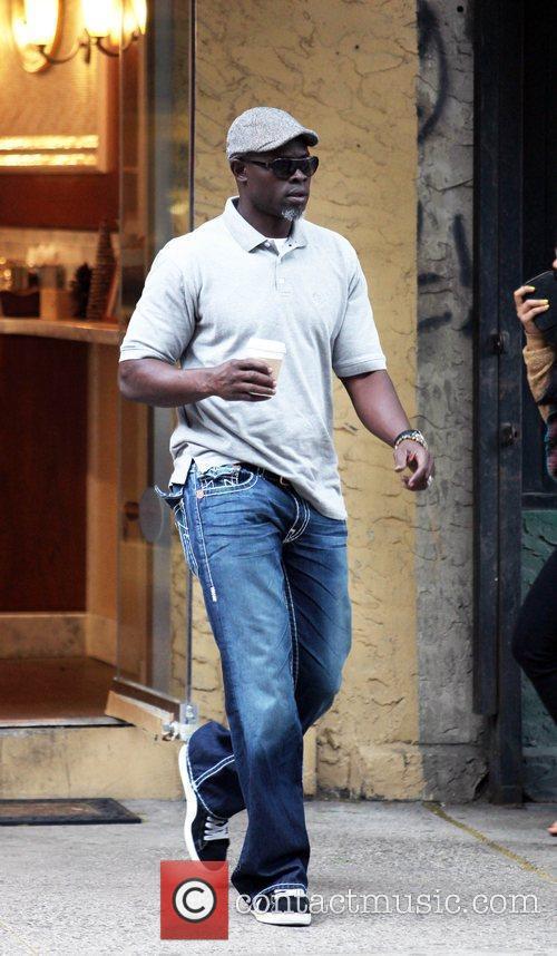 Djimon Hounsou goes into several shops in SoHo...