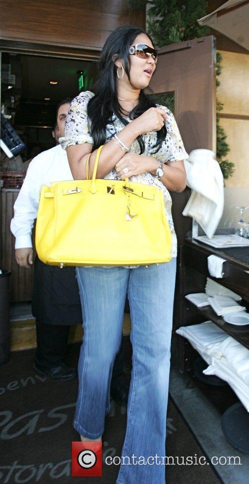 Kimora Lee Simmons, Djimon Hounsou and Russell Simmons 2