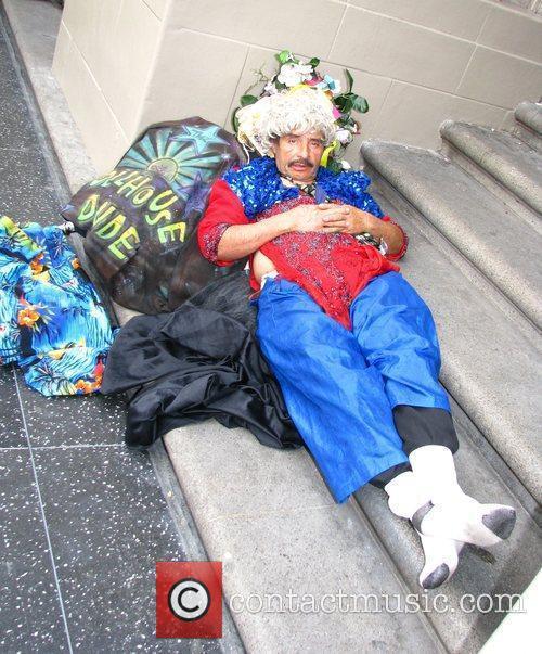 Celebrity vagrant Dollhouse Dude outside the Kodak Theater...