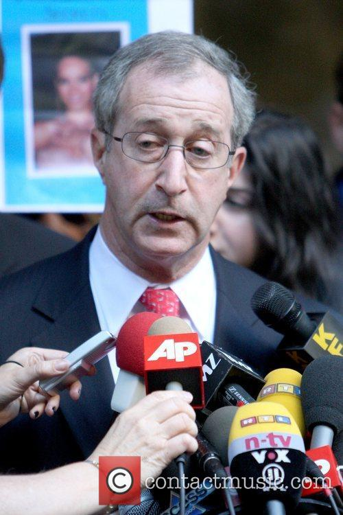 Rihanna's attorney speaks during a press conference outside...