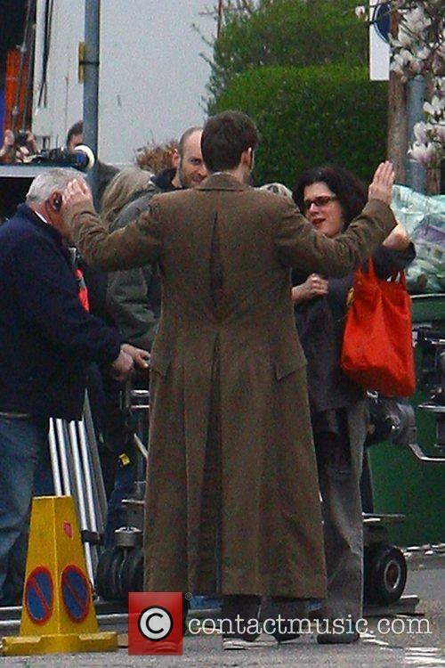 David Tennant kisses and hugs a fan while...