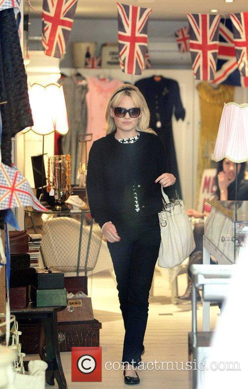 Visits a boutique in North London, dressed in...