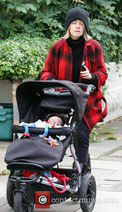 Pushes her son Rudy in a pushchair in...