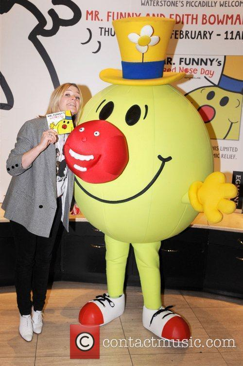 Attends a photocall with 'Mr.Funny' for Red Nose...