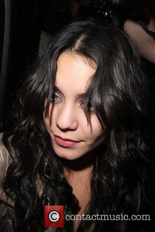 Vanessa Hudgens  is surrounded by photographers when...