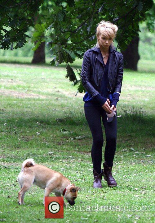 Plays with her dog in the park