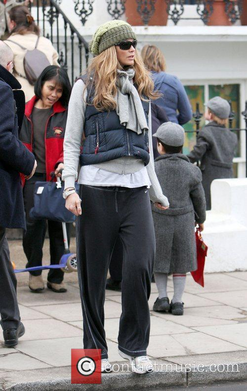 Elle Macpherson makes her way home after taking...