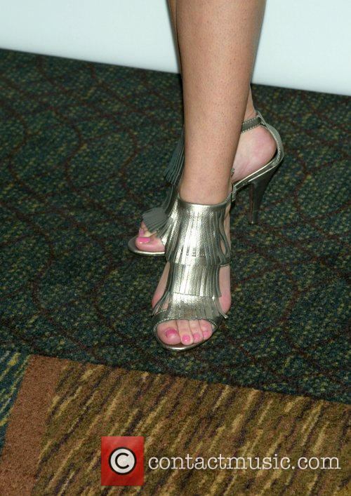 Anna Camp shows off her shoes at the...