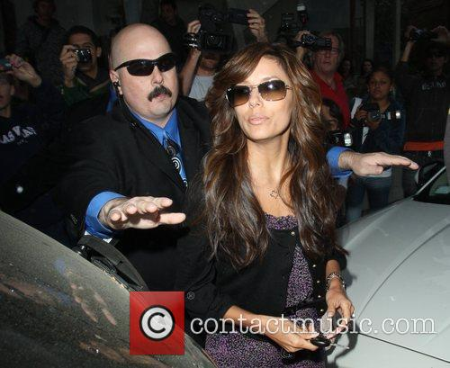 Is escorted by bodyguards as she leaves the...