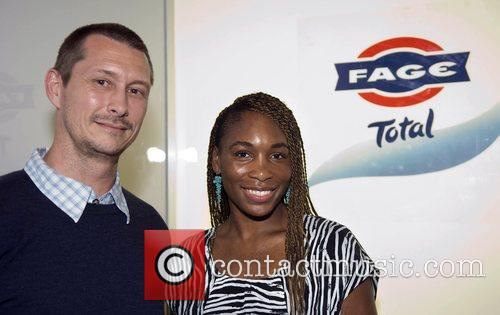 Attends the FAGE Total Artistry Exhibit during Art...