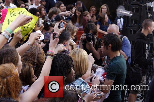 Pete Wentz of Fall Out Boy signs autographs...