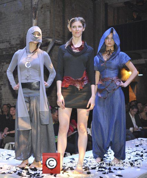 Model takes to the catwalk wearing designs by...