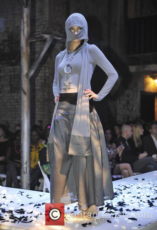 Model takes to the stage wearing Evan Biddell...