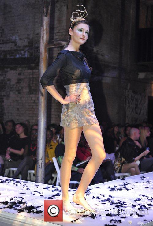 Model takes to the stage wearing Monica Mei...
