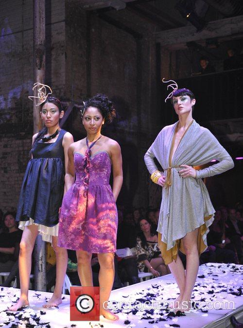 Models take to the catwalk wearing designs by...