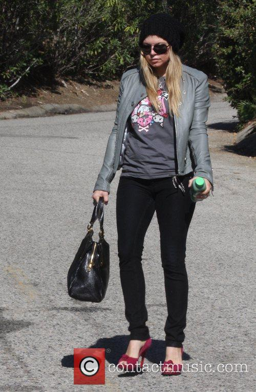 Fergie aka Stacy Ferguson leaves her home and...