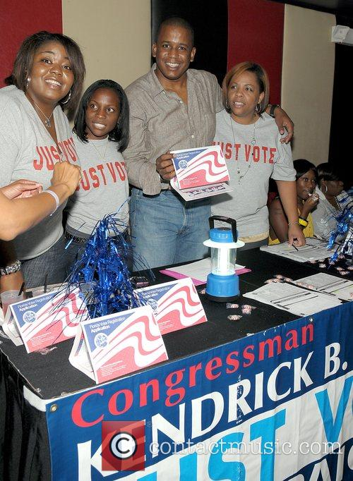Kendrick B. Meek at the voter registration table...