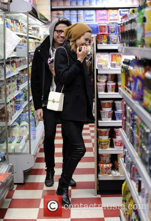 Nick Grimshaw and Alexa Chung stop in a...