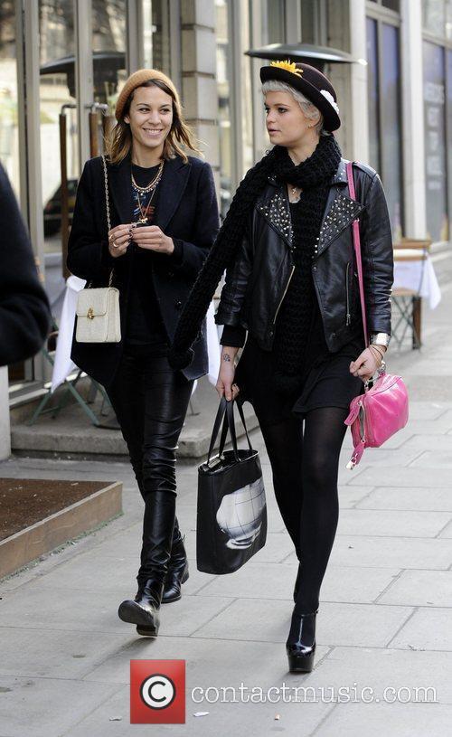 Alexa Chung and Pixie Geldof laugh and joke...