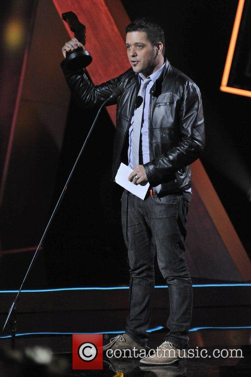 George Stroumboulopoulos accepting an award at ,...