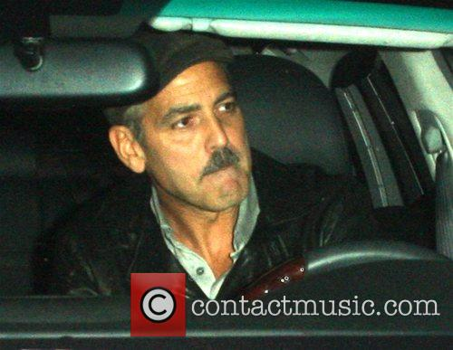 George Clooney is wearing a strange new moustache...