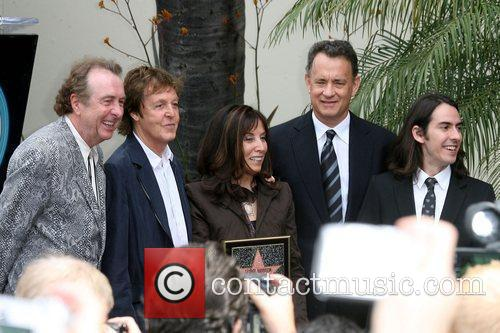 Eric Idle, George Harrison, Olivia Harrison and Tom Hanks 5