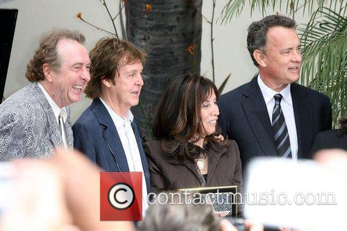 Eric Idle, George Harrison and Olivia Harrison 3