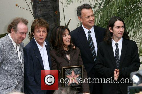 Eric Idle, George Harrison, Olivia Harrison and Tom Hanks 1