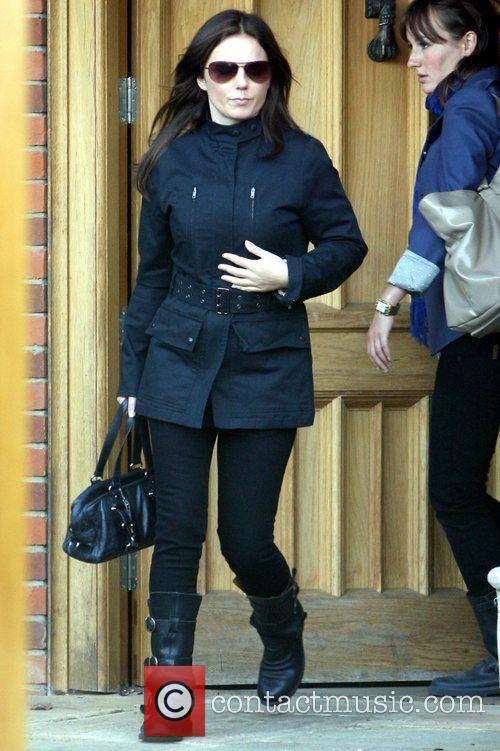 Geri Halliwell leaving her house this afternoon sporting...