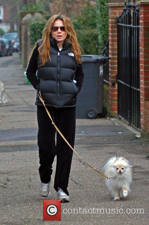 Geri Halliwell takes her dog out for a...