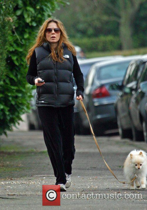 Geri Halliwell using her phone whilst out walking...