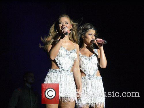 Performing live in concert as part of their...
