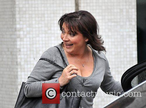 Lorraine Kelly struggles to avoid an April shower...