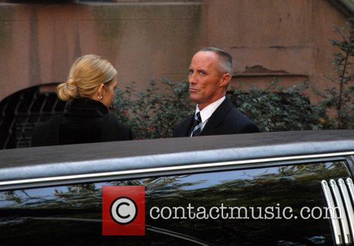 Kelly Rutherford and Robert John Burke on the...